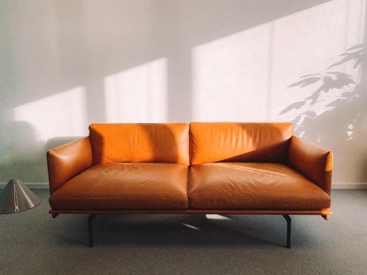Home staging mistakes - orange sofa